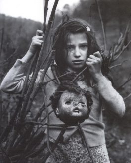 Historic Photo – Girl with Doll Head